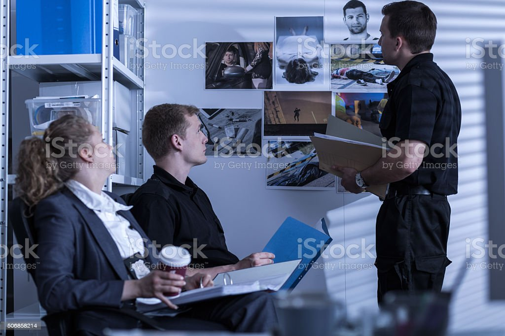 Police cooperating with private detective stock photo