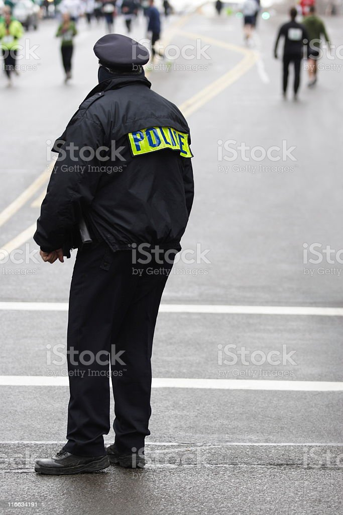 Police Coordinate Traffic Athletes Running 5K Race stock photo