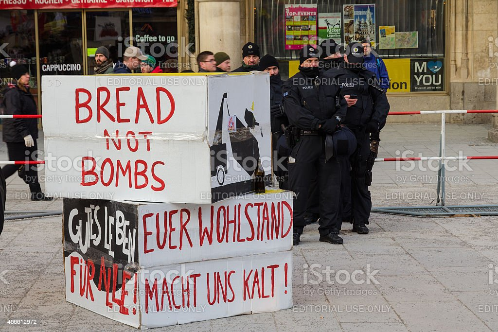 Police cordon and signs banners on protest rally anti-NATO demon stock photo