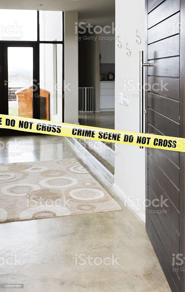 Police cordon tape across front door stock photo
