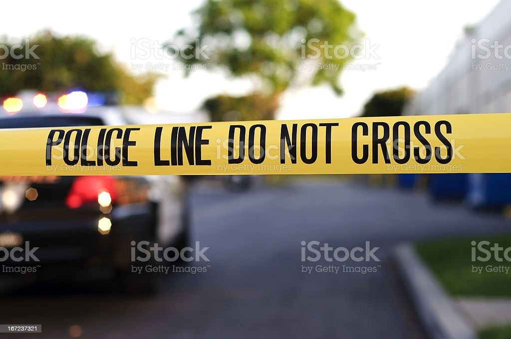 A police crime scene tape close-up stock photo