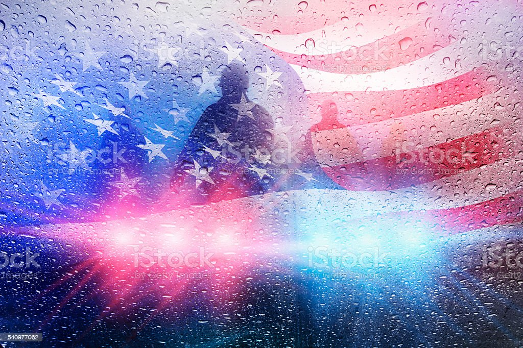 Police crime scene with lights and raindrops and american flag stock photo