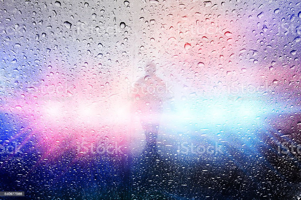 Police crime scene with lights and raindrops stock photo