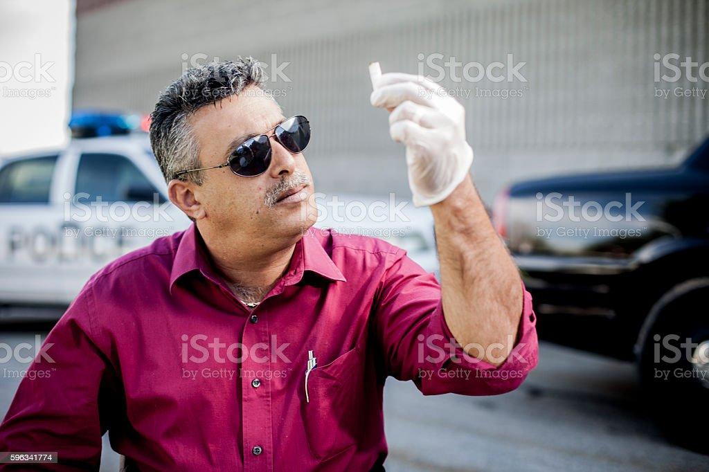 Police Detective at Crime Scene stock photo