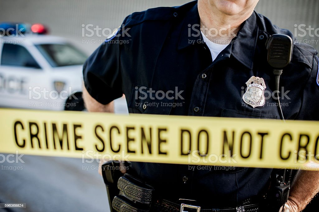 Police Detective at Crime Scene stock photo