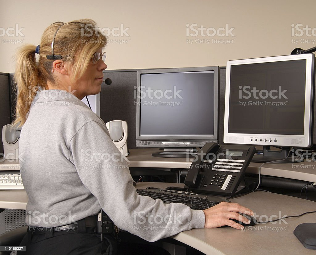 Police dispatcher working at console stock photo