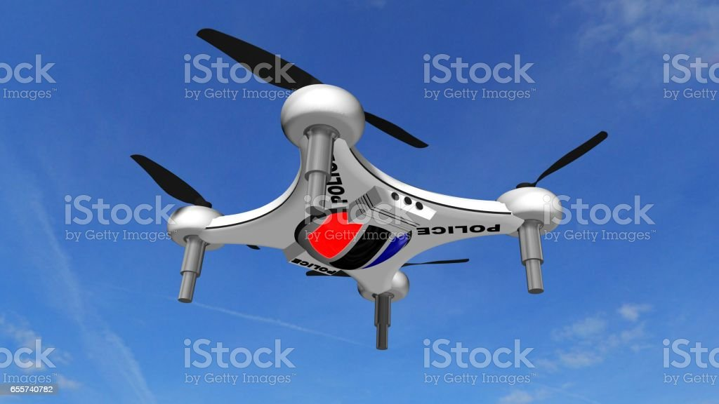 Police Drone Quadrocopter flies in the blue sky - Autonomous traffic monitoring stock photo
