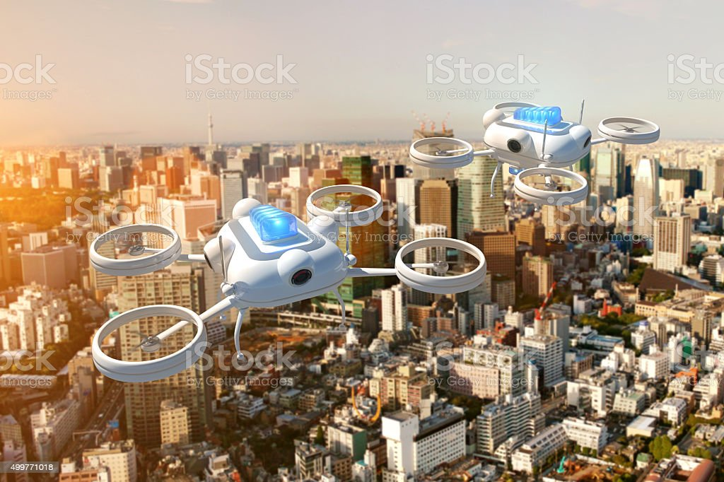 Police drone with blue emergency lights flying over a city stock photo