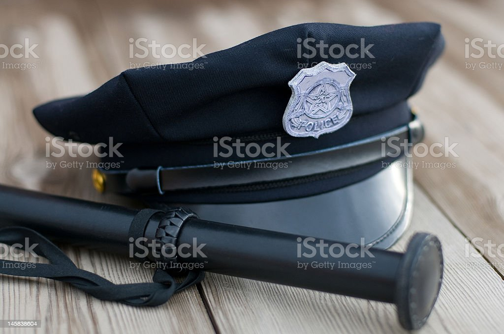 Police equipment. Hat and truncheon royalty-free stock photo