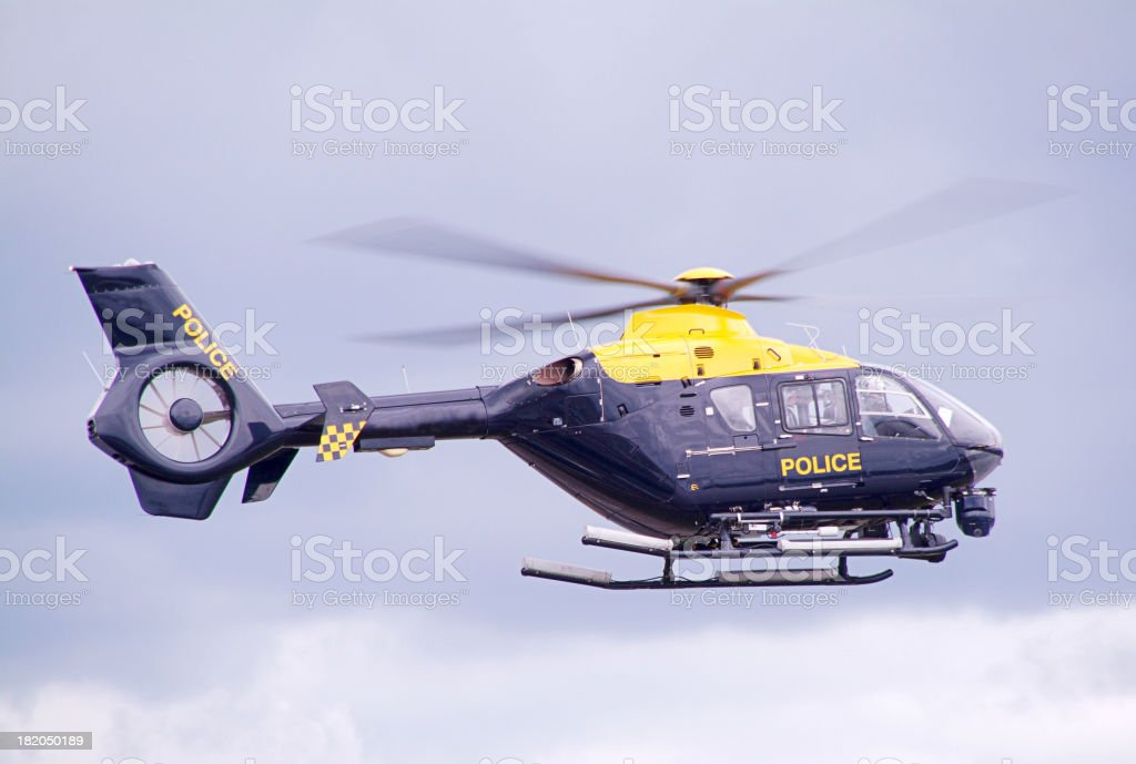 police helicopter in flight royalty-free stock photo