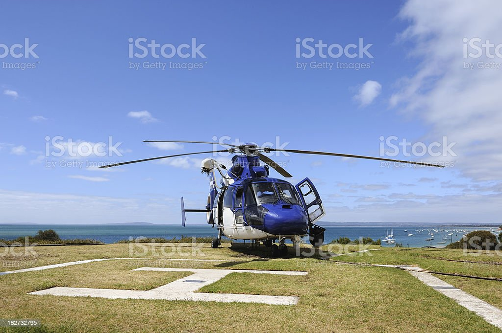 Police Helicopter Parked on Helipad royalty-free stock photo