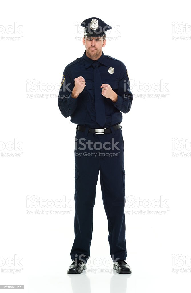 Police in fighting stance stock photo