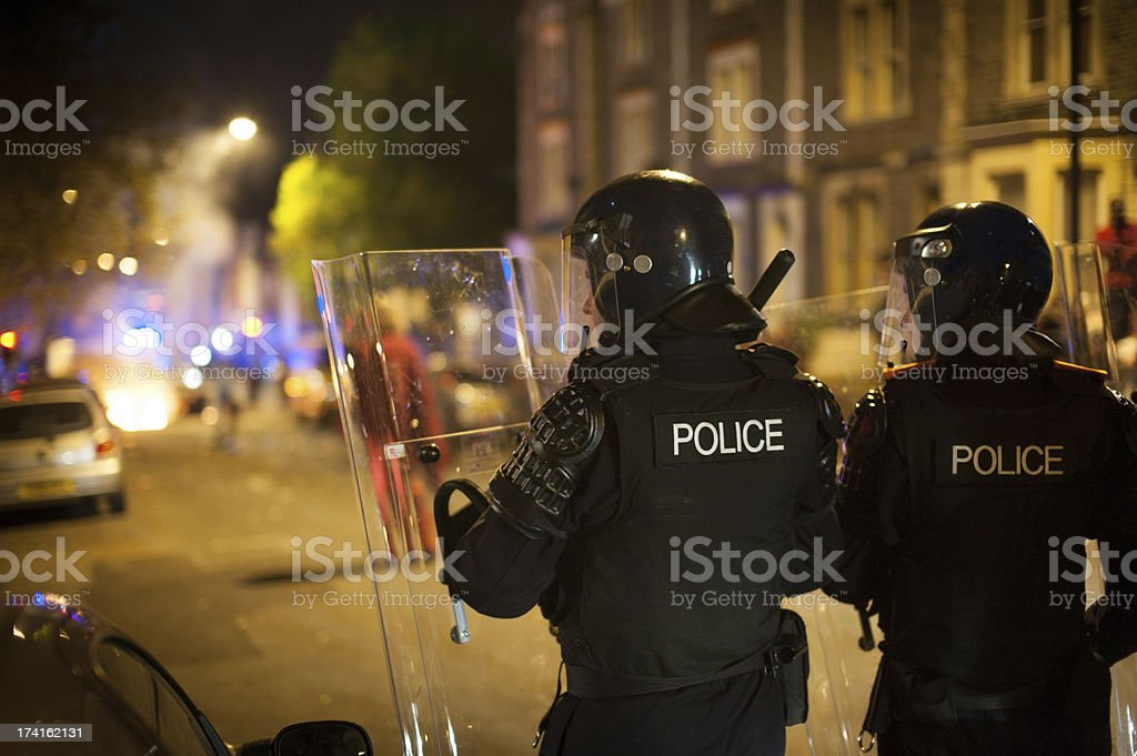Police in riot gear with shields on the street stock photo
