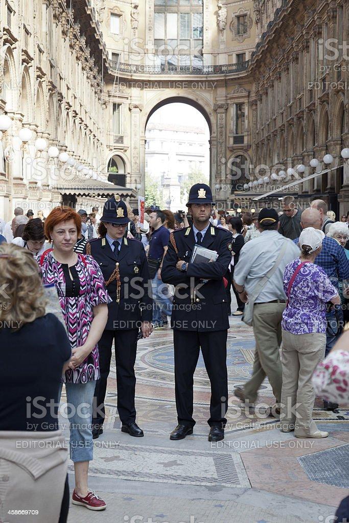 Police in the Galleria Vittorio Emanuele II, Milan, Italy royalty-free stock photo