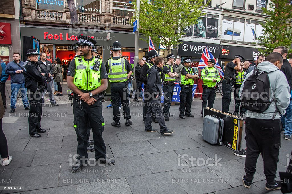 police keep right wing and socialist seporate stock photo