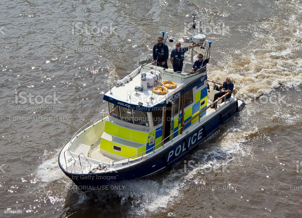 Police launch travelling down the River Thames stock photo