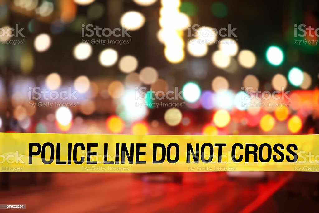 Police line do not cross: city nightlife with traffic lights stock photo