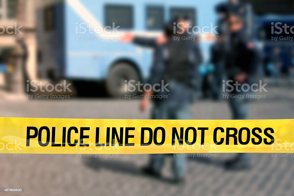 Police line do not cross: policemen block the street stock photo
