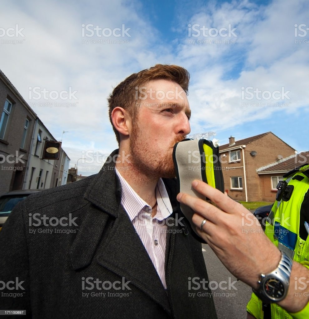A police man giving a man an alcohol test stock photo