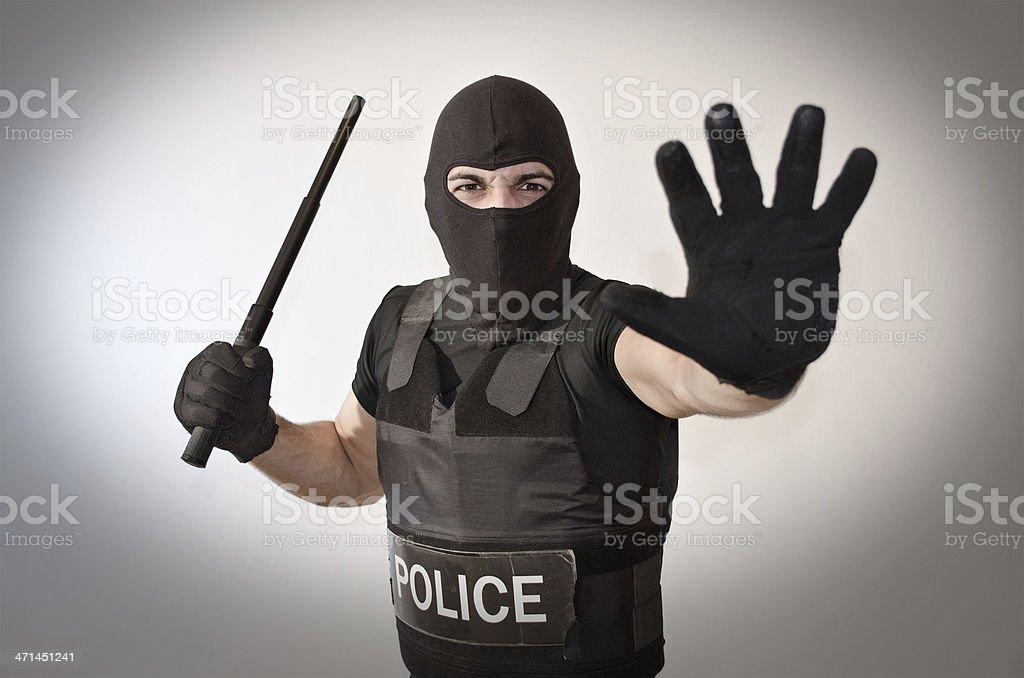 Police man signals stop stock photo