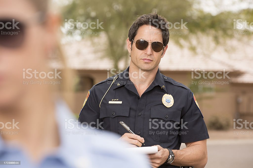 Police Man with his partner on a traffic stop royalty-free stock photo
