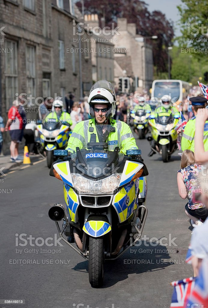 Police Motorcycle outrider keeping crowds safe stock photo