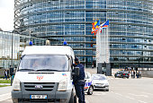 Police Nationale officer france CRS surveilling Euopean PArliame