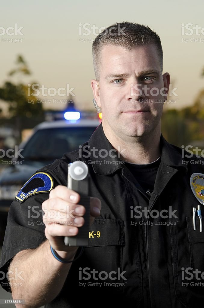Police office with a breath test machine royalty-free stock photo