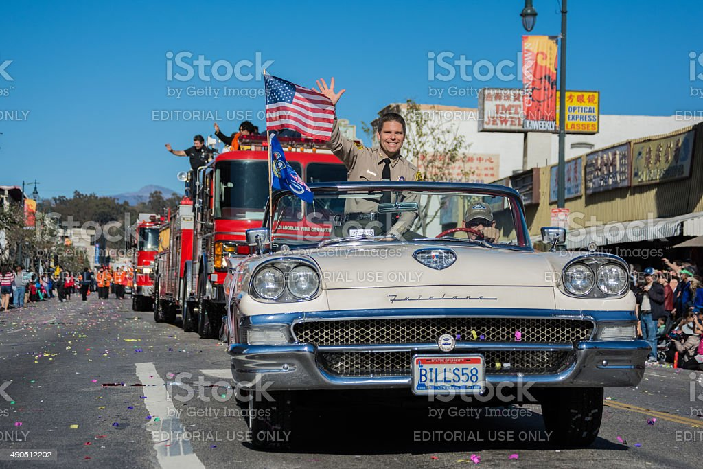 Police officer and fire trucks during the Golden Dragon Parade stock photo