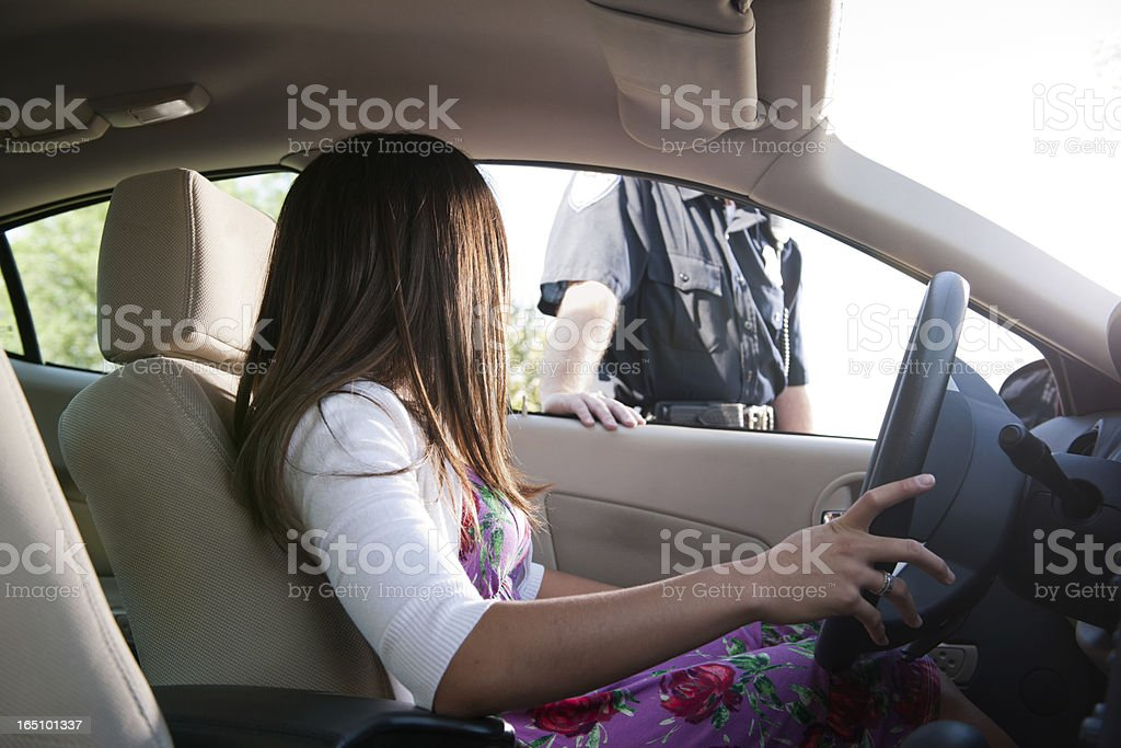 Police Officer Approaches Female Driver stock photo