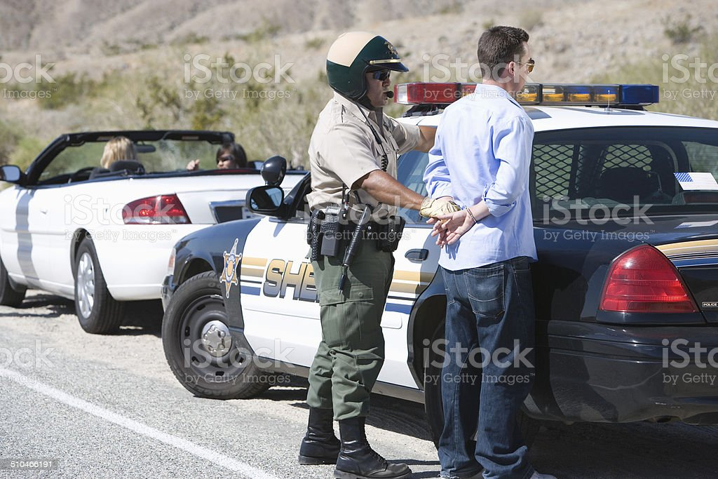 Police officer arresting driver stock photo