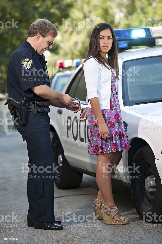 Police Officer Arresting Female Driver stock photo