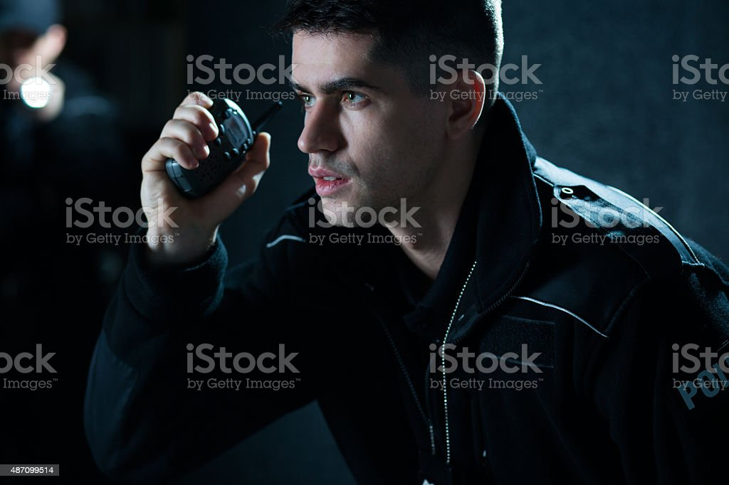 Police officer at action stock photo