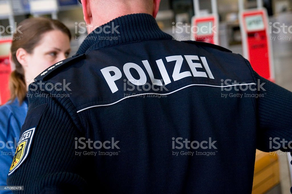 Police Officer Checks a Young Woman stock photo