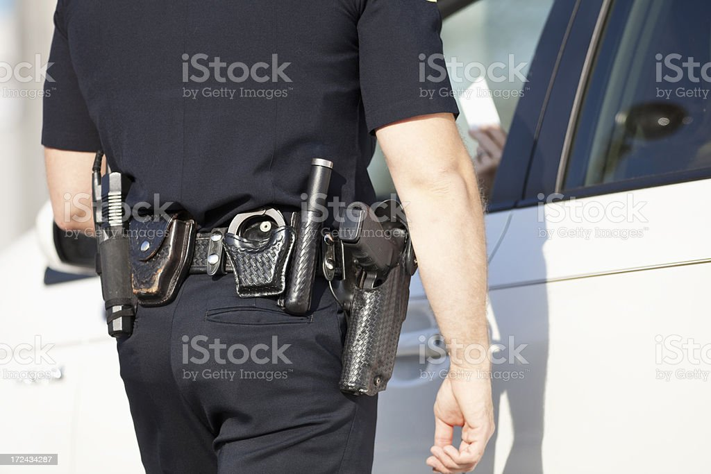 Police officer giving a ticket royalty-free stock photo
