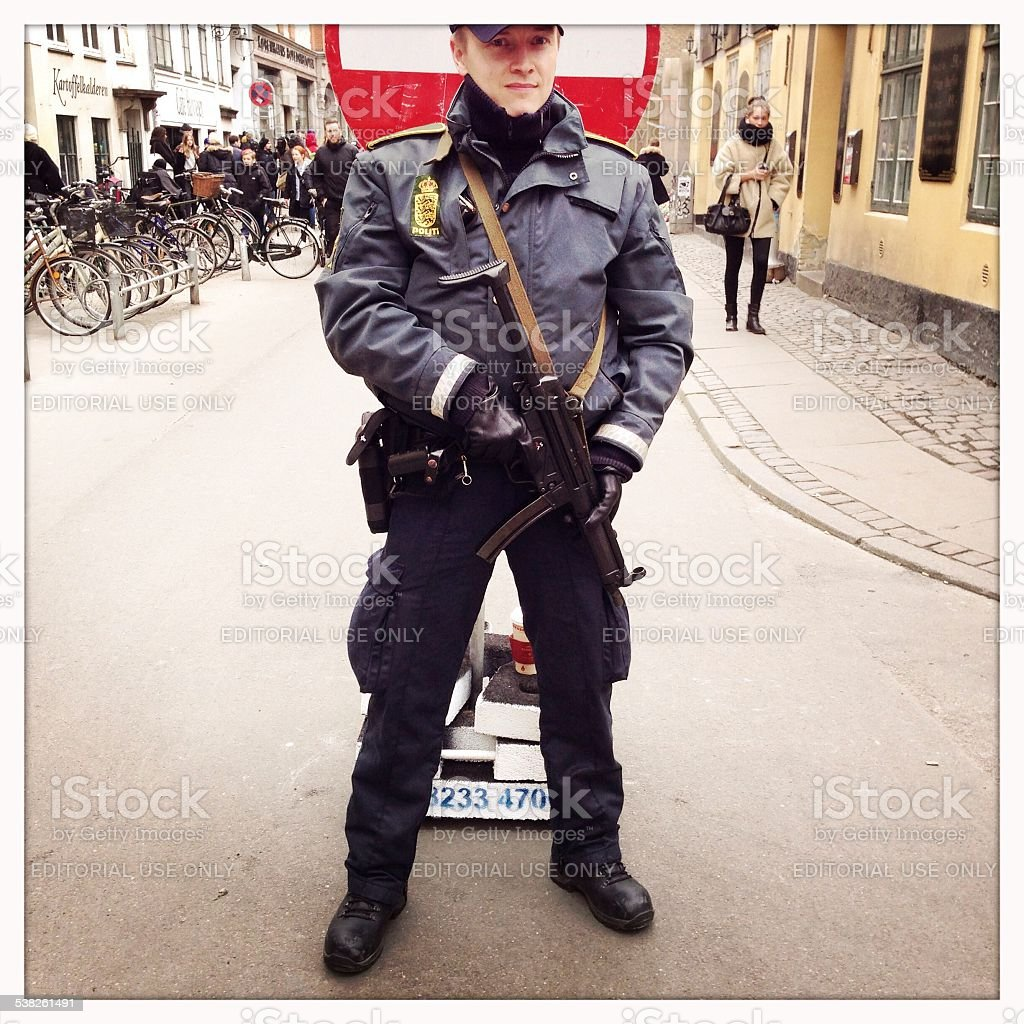 Police officer guarding synagogue in Copenhagen stock photo