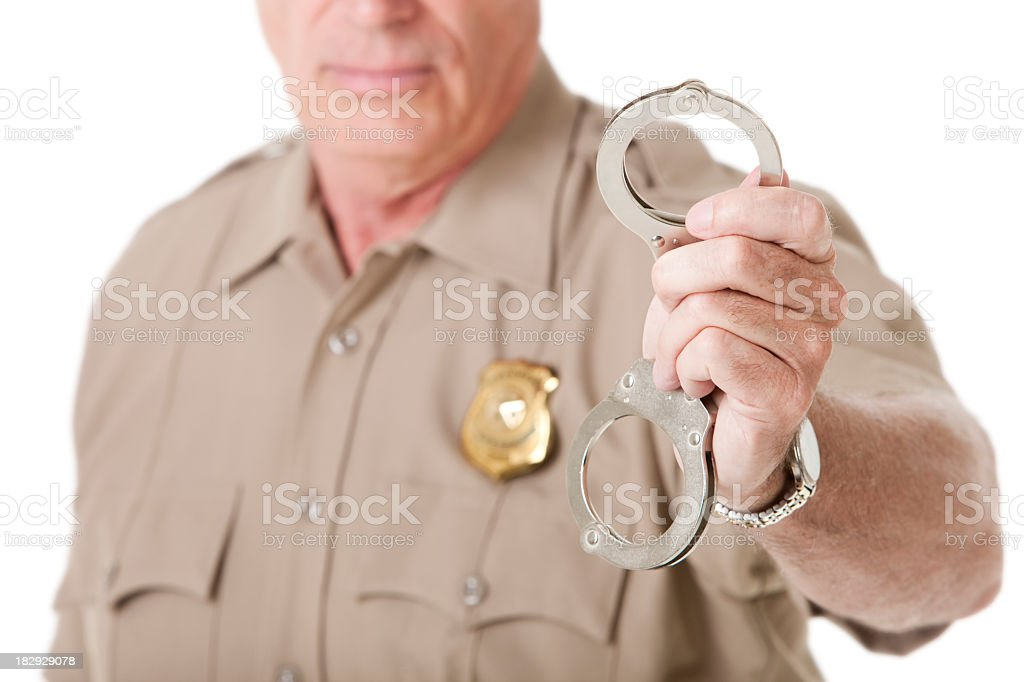 Police Officer Holding Out Handcuffs royalty-free stock photo