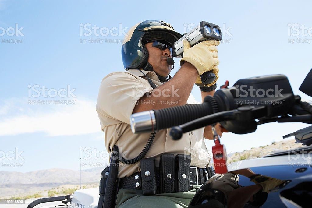 Police Officer Holding Radar Gun stock photo