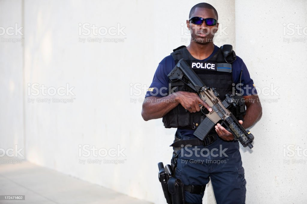 Police officer holding rifle royalty-free stock photo