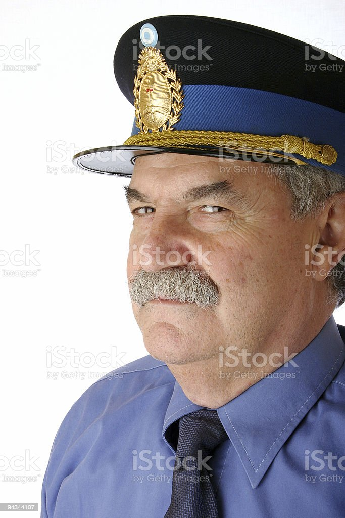 Police officer in blue uniform looking at you stock photo