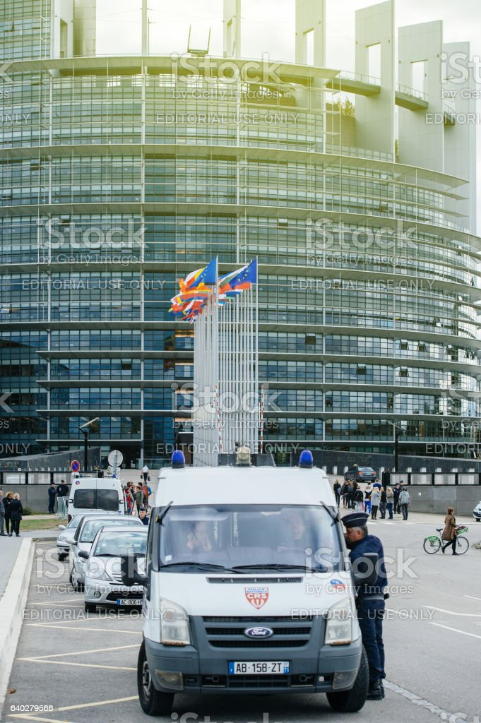 Police officer in front of European Parliament during official visit stock photo