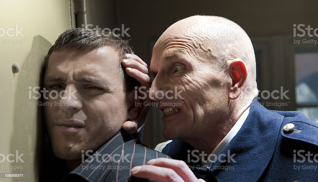 police officer interrogating criminal stock photo