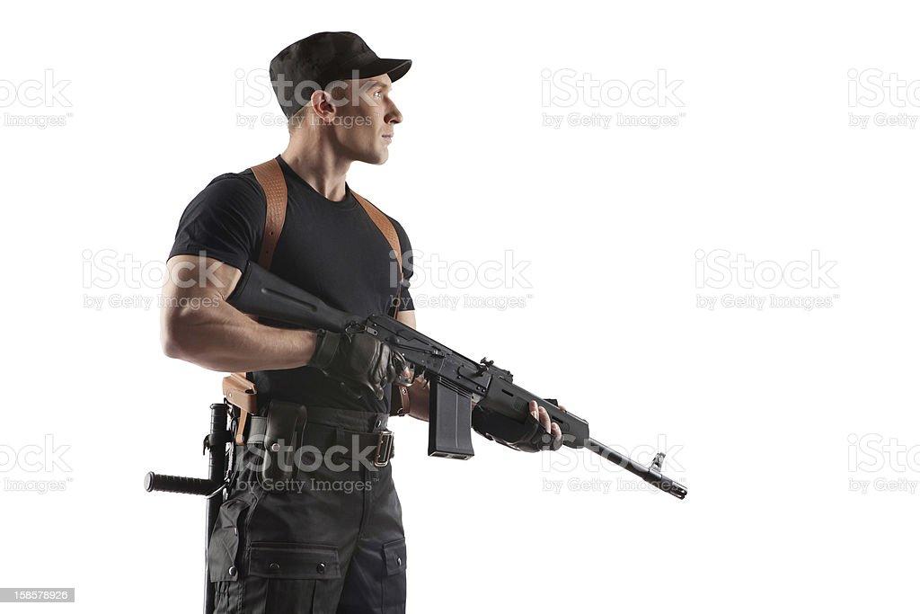 Police officer is holding Kalashnikov stock photo