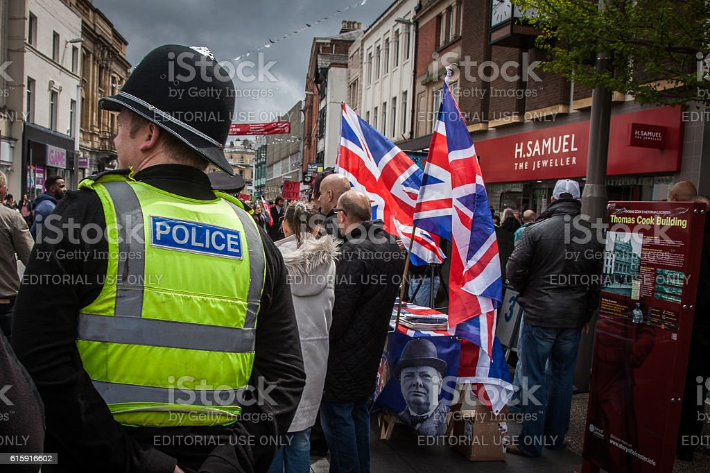 police officer looking at people as right wing group campains stock photo