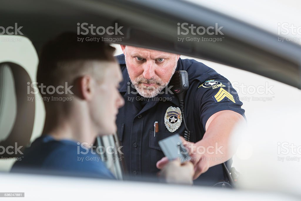 Police officer making a traffic stop stock photo