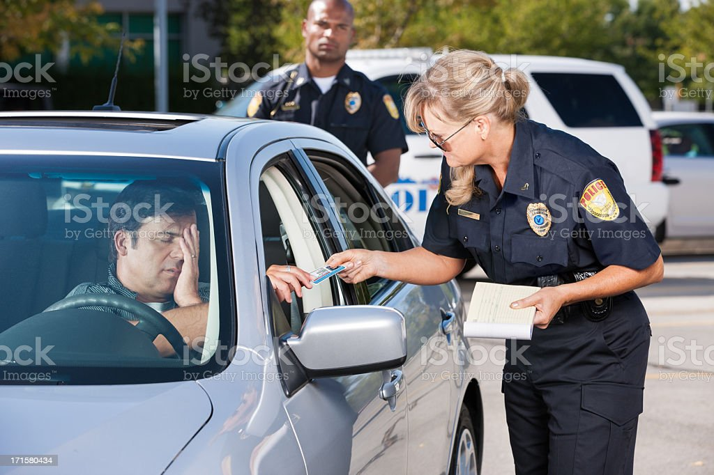 Police Officer Making Traffic Stop stock photo