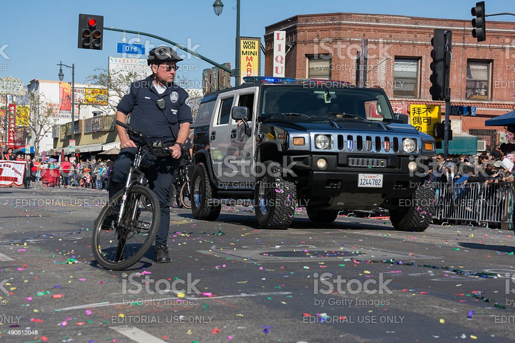 Police officer on bike and Hummer police car stock photo