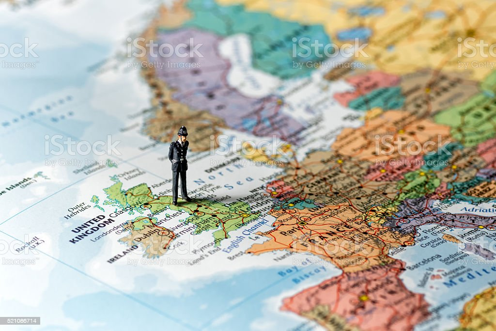 Police officer on the map of the world. stock photo