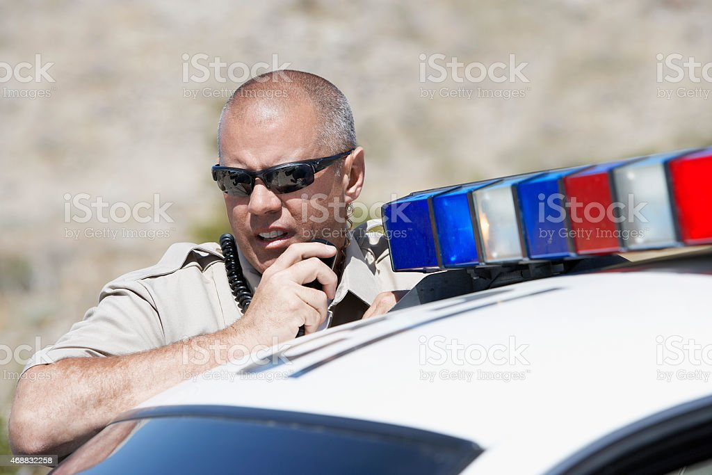 Police Officer on Two-Way Radio stock photo