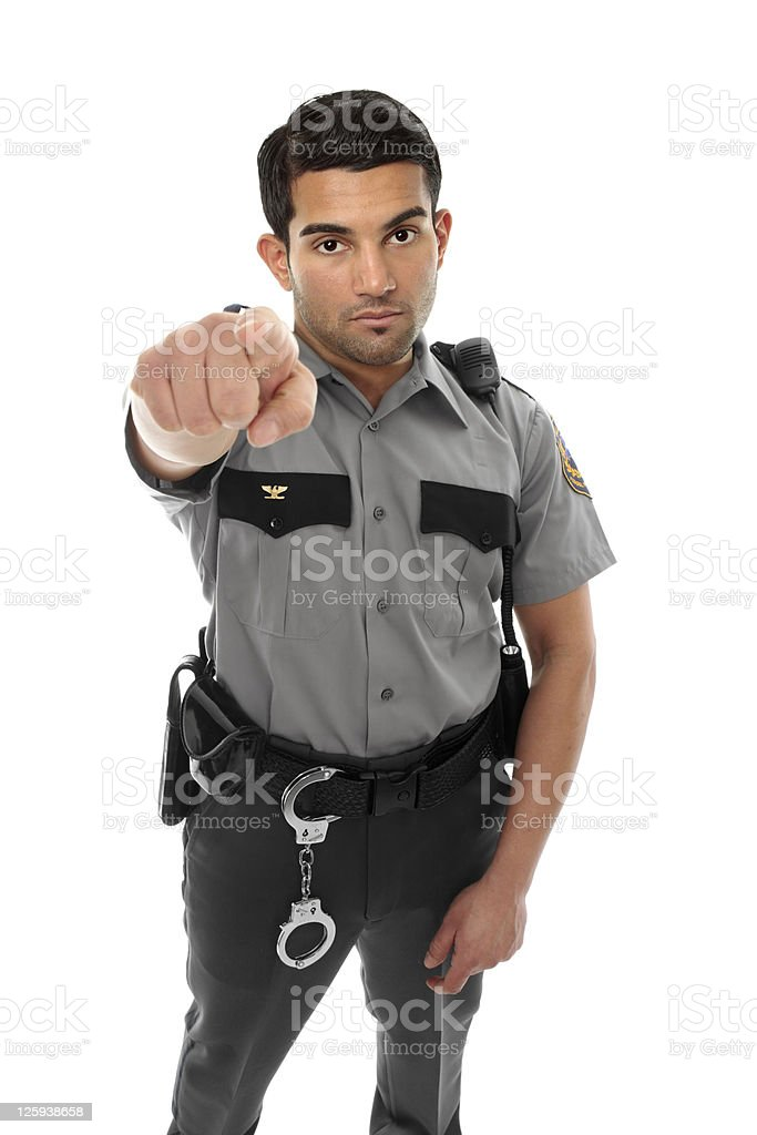 Police officer or prison guard pointing his finger stock photo